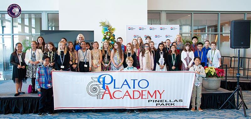 Plato Students sing carols at Tampa airport