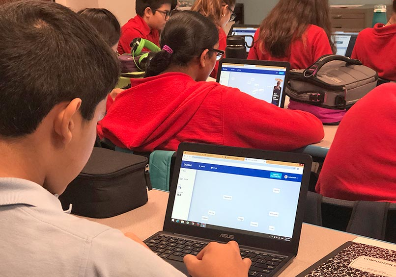 Students working on laptops in class