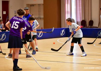 Plato Academy Students playing hockey