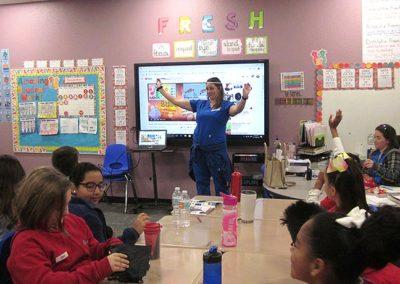 volunteer teaching in a plato academy classroom during GATI 2019