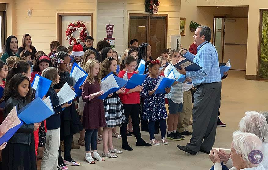 Students singing carols